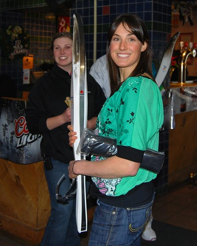 Brittany Webster with 2010 torch at Toronto Brewery Visit