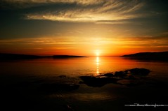C View (Panos Mavromytis - ) Tags: morning red sea summer cloud sun beach water silhouette yellow clouds sunrise island greek rising rocks stones calm greece rise greekislands goldenhour yellowsun goldencolors summeringreece mainlandgreece greeksummer