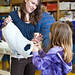 Student teacher Ellie Hampton helps elementary children make parachutes.