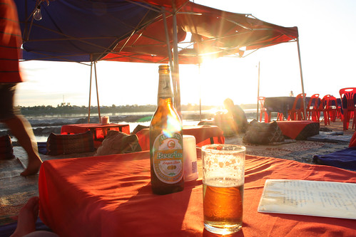 Watching the sun set on the Mekong River