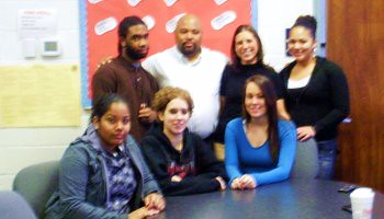Inside the Excel Academy South in Nothwood, Northeast Philadelphia, Executive Director Milton Alexander stands with Stephanie Buca and a select group of the interviewed honor students.