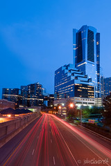 Buckhead Skyline Looking South on the Tollway (James Duckworth) Tags: atlanta sunset sky cars skyline architecture night clouds buildings office dusk marta lighttrails bluehour buckhead martastation jimduckworth jamesduckworth jamesduckworthphotography