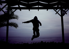 (ssj_george) Tags: blue sea plants man tree beach water silhouette night lens lumix person jump jumping hands alone purple sundown horizon cyprus palm panasonic solo single kiosk poles pancake 20mm leap larnaca makenzie larnaka kypros f17 gf1 kipros  georgestavrinos  ssjgeorge