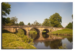 CHATSWORTH REFLECTIONS (vicki127.) Tags: longexposure bridge trees grass reflections mr canon300d derbyshire bluesky vicki chatsworthhouse burrows canon1855mm digitalcameraclub topshots youmademyday flickraward thisphotorocks ilovemypics natureselegantshots june2011 100commentgroup artofimages hairygitselite absolutelyperrrfect adobephotoshopcs5 ringexcellence ringofexcellence vicki127