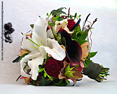 woodsy-bridesmaid-bouquet (Blossom Wedding Flowers) Tags: red white black green coffee beauty rose moss berries lily calla antique maroon gothic ivy earthy romantic casablanca lillies birch twigs helleborus freesia woodsy viburnum metalina