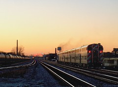 Westbound Metra commuter local heading in to a winter sunset. Chicago Illinois. December 2006.