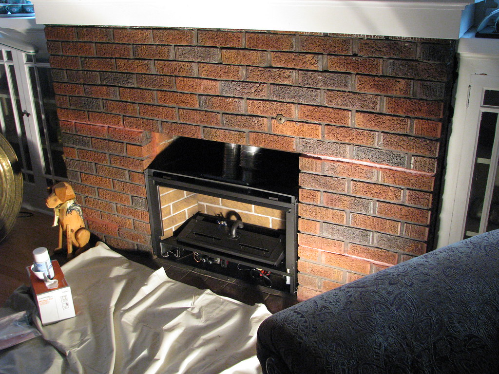 Gas fireplace insert, partially installed.