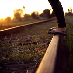 standing on the edge of me (orangetuwie) Tags: railroad light sunset sun film grass train 35mm golden lyrics shoes rocks tracks slide flats electro gsn switchfoot yashica brea onfire 100iso afga