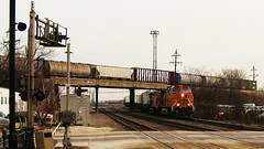BNSF Railway intermodal switching movement passing underneath a westbound Canadian National freight train. Berwyn Illinois. Febuary 2010.