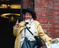 "Very friendly yet slightly mad woman in Taipei who said her job was a ""juice importer"" (deepstoat) Tags: street portrait colour 120 film mediumformat taiwan peanuts snoopy roll loopy mamiya7ii kodakportra deepstoat"