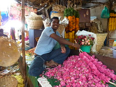More beautiful flowers being strung. (Rexfree_99) Tags: flowers india church traffic madras transportation temples chennai stthomas gopurams marketscenes