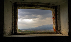 View from the crumbling barn's window - Vista dalla finestra del fienile diroccato (Robyn Hooz) Tags: light ex window clouds canon nuvole sigma hills finestra frame polarizer 1020 luce colline cornice temporale fienile veneto mattoni conegliano prealpi granaio polarizzatore hsm mywinners 1000d