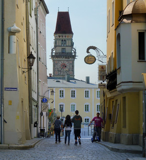 My family strolling towards the Altes Rathaus of Passau