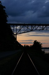 DSC05874adj-rs Into the Night (ftoomschb - I block industrial-strength followers) Tags: county railroad bridge sunset lines night river point twilight darkness dusk sony tracks explore highland walkway valley hudson alpha dslr vanishing leading ulster 218 a700
