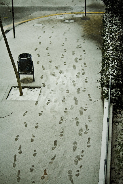The footprints near the bin