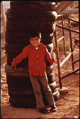 Navaho Boy Leans Against Tower of Discarded Tires. Lack of Disposal Facilities Is A Common Problem in Remote Areas of the Navaho Reservation (The U.S. National Archives) Tags: boy tower child tires problem navajo discarded navajoreservation leaning discard reservation lean environmentalprotectionagency documerica usnationalarchives nara:arcid=544357
