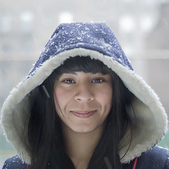 Lucy. (Vitaliy P.) Tags: new york city nyc morning portrait pierced woman snow cold girl smiling lady silver project square nose 50mm lucy hoodie nikon warm young smiles piercing ring jacket crop hood year2 snowing 365 f18 flakes reflector eskimo month10 project365 d80 vitaliyp thischarmingbroad rightofmodel
