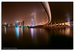 Curving The Burj K. (DanielKHC) Tags: bridge water night bay interestingness high nikon long exposure dubai dynamic uae business explore khalifa range fp frontpage 19 dri hdr futuristic burj d300 danielcheong nikkorfisheye105mmf28 bratanesque danielkhc chocolatehour gettyimagesmeandafrica1