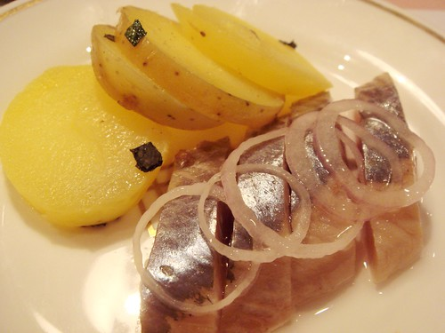 Russian salt-cured Herring, raw onion rings and new potatoes
