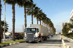 TRUCKING IN CYPRUS (Claude  BARUTEL) Tags: sea truck turkey island mediterranean harbour transport cyprus cranes partition divided trucking containers limassol