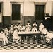 Salvation Army Day Care Nursey,  183 Transit Street. circa 1933 - 34.  Robert F. Anthony in the playpen, far right with his arms out.