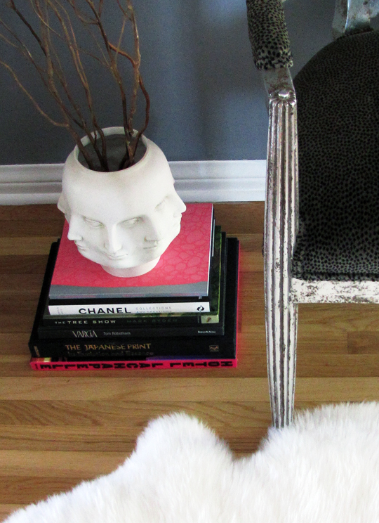 face vase+sheepskin+animal print chair+books+living room nook