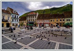 BRASOV (Nathan Bergeron Photography) Tags: light sunset people colour architecture clouds buildings heineken geotagged restaurant europe wideangle medieval tourists tokina cobblestone patio romania parkbench transylvania 1224mm easterneurope brasov marketsquare wideview mainsquare colourfulbuildings braov carpathianmountains yearinfrance t