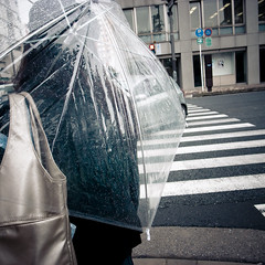 Clear VInyl Umbrella Girl (jacob schere [in the 03 strategically planning]) Tags: wet rain weather bag see spring day cross walk cement bad soak rainy covered shoulder though drizzle seethough