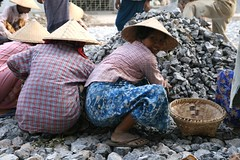 Peasant women making new road surface, Mandalay (Tom Spender) Tags: road woman smile hat stone work women asia stones burma hard surface labour myanmar mandalay peasants slog peasant roa labourers