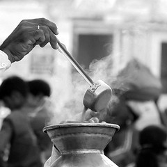 Chai, garam masala chai (tea, hot masala tea) (... Arjun) Tags: travel blackandwhite bw 15fav india hot cup monochrome 1025fav rural 510fav iso100 blackwhite asia warm dof tea bokeh smoke spice monotone 2550fav spices vendor turban f56 tribe pushkar 2009 rajasthan 105mm hottea rajput teavendor masalachai canonef24105mmf4lis spicedtea bluelist chaiwalla canoneos5dmarkii    canon5dmarkii  gettyvacation2010