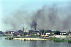 Nile River industrial scene, 1997 (Richard Rodgers_melb.aus) Tags: travel film 35mm river landscape boats industrial smoke egypt scene nile pollution riverboat 1997 negativescan riverscene