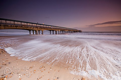 (Claire Hutton) Tags: longexposure pink blue sunset sea white beach water weather clouds coast pier twilight sand waves stones jetty sandy wideangle stormy pebbles wash coastal foam bluehour rolling slowshutterspeed