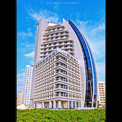 Al Seef Hospital, Kuwait [HDR] (alvin lamucho ) Tags: road street city plants building tower architecture modern clouds photography seaside gulf details blues busy commercial kuwait residential 1022mm hdr burj salmiya photomatix rebelt1i alvinlamucho alseefhospital