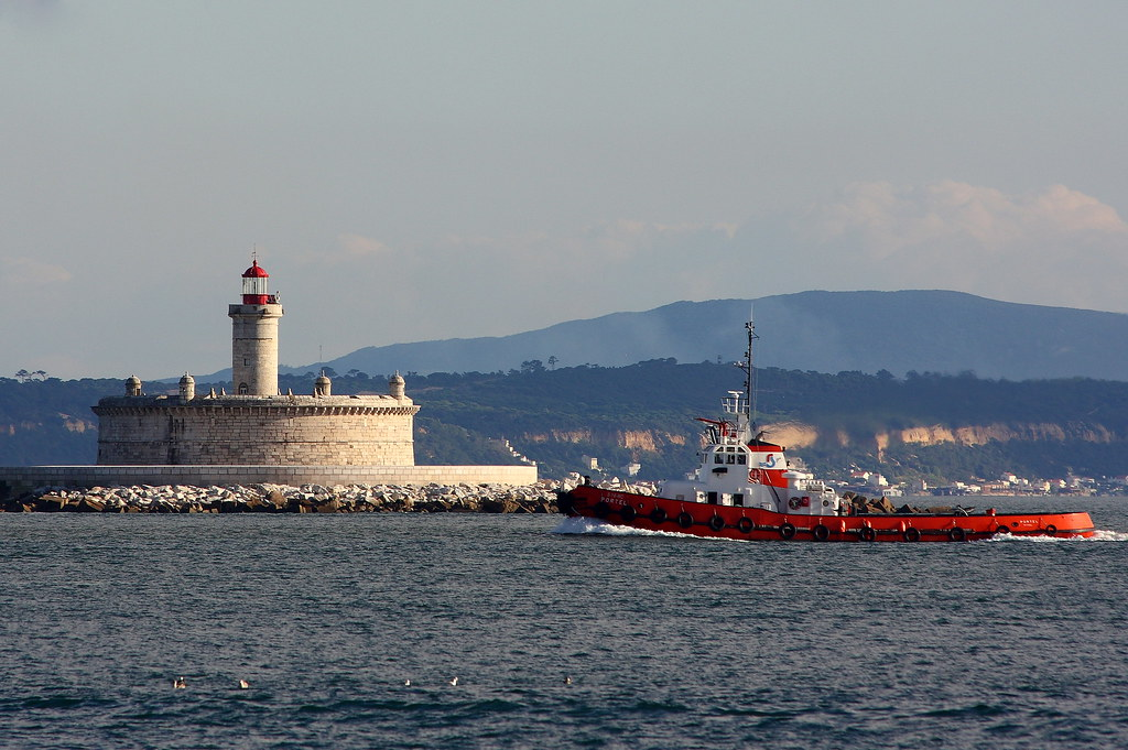 The lighthouse and the towboat