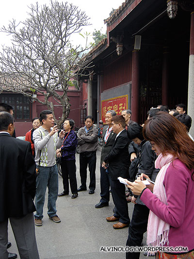 Our guide, Weijian, briefing us on the temple history