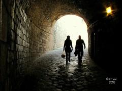 You'll Never Walk Alone... (www.tiotxus.com) Tags: barcelona travel light party vacation people love luz home canon pareja tunnel solo caminar futbol tunel castillo montjuc castell txus sx10 tiotxus