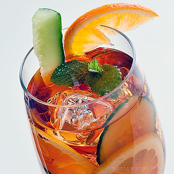 Pimm's Cup garnished with Cucumber, Lemons, and Orange