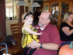 Trying to get at the candy in grandpa's pocket! (Ludeman99) Tags: joe halloween2009 eowynlouisebitner