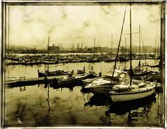 The dock (in eva vae) Tags: morning light sea bw italy seascape reflection art texture nature water monochrome sepia boats bay dock eva italia liguria experiment quay hdr laspezia sailsevenseas inevavae