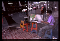 "Blindness in Bangkok, city of angels II (Sailing ""Footprints: Real to Reel"" (Ronn ashore)) Tags: people color slide nikonf3 blindness fuji100 nikkor28mmf28ais bangkokcityofangels 2009oct068f3fuji10028nnf28bkkmultipleexposures"