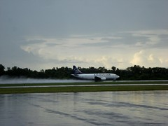 First departure after the rain (Indo Pilot) Tags: wet rain clouds airport 365 boeing takeoff runway 737 balikpapan sepinggan 3652010