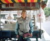The biggest fanny pack in Taiwan, caught on camera (deepstoat) Tags: street portrait 120 film mediumformat taiwan roll vendor fannypack mamiya7ii kodakportra deepstoat