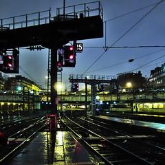 Saint Lazare #26 (philoufr) Tags: paris reflection rain station night train square pluie quay reflet nuit quai sncf garesaintlazare carrfranais canonpowershots90