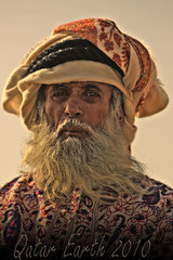 Old man wearing Arab dress HDR by Qatar Earth 2010 (Qatar Earth  ) Tags: old man wearing by dress earth arab hdr qatar 2010