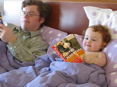 Speck and her Daddy reading in bed