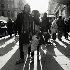 Love is the drug (Ian Brumpton) Tags: street england blackandwhite bw london blancoynegro blackwhite couple noiretblanc candid streetphotography piccadillycircus londres contrejour biancoenero lamore lovedup loveisthedrug londonstreetphotography lifeinslowmotion scattidistrada blackwhiteheartbeats