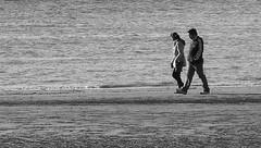 Water's edge walkers (* RICHARD M (Over 5.5 million views)) Tags: beach water monochrome liverpool mono blackwhite candid waterloo telephoto rivers merseyside sefton rivermersey
