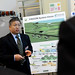 Director of NSF FREEDM Systems Center Alex Huang talks with visitors on Centennial Monday.