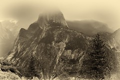 An Antique Portrait of Half Dome (Yosemite National Park) (thor_mark ) Tags: blackwhite capturenx2edited centralyosemitesierra cloudsacrossvalley cloudsaroundmountains cloudsinvalley colorefexpro day3 evergreens glacierpoint grizzlypeak halfdome hillsideoftrees illilouettegorge libertycap littleyosemitevalley lookingne lowclouds mountbroderick mountains mountainsindistance mountainsoffindistance nature nikond800e overcast pacificranges project365 sierranevada silverefexpro2 trees triptopasoroblesandyosemite yosemitenationalpark yosemitevalley yosemiterittersierranevada ca unitedstates
