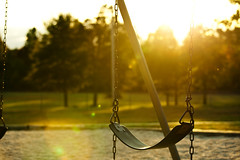 School Bells Ring Again, Lonely Swings Again (Brandon Christopher Warren) Tags: autumn trees sun grass childhood playground chains nc glare bokeh swings photographers northcarolina pebbles flare innocence swingset newmarket sophia goldenhour teenage asheboro canoneos5dmarkii 70200mm4lisusm newmarketelementaryschool